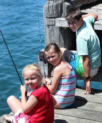 Caitlin Te Tai, 7, of Invercargill, fishes with Piper Spencer, 9, and Griffyn Spencer, 11, both from Christchurch. All three joined the summer crowds of people at Riverton.