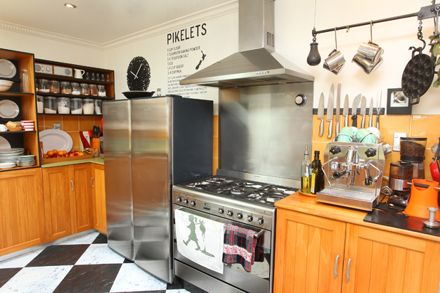 New life: White walls and a pikelet recipe give new life to an old kitchen.