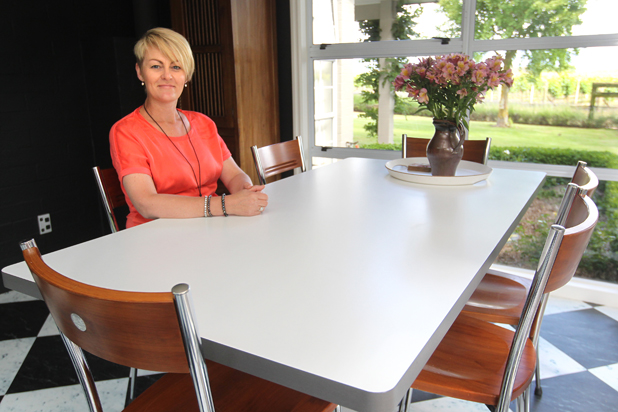 At home: Conny van der Geest's table top was replaced with white formica, in another make-do do-up
