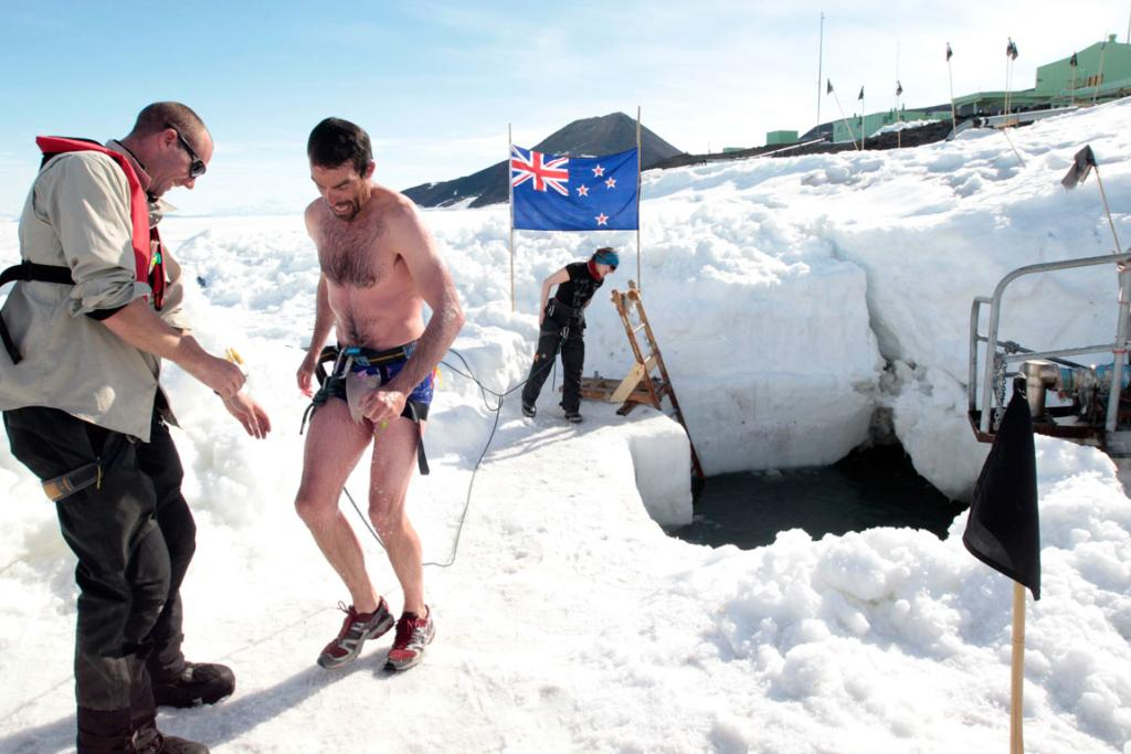 Antarctica New Zealand field training instructors Richie Hunter, left, Drew Coleman and Anthea Fisher after Coleman's polar plunge at Scott Base in Antarctica.