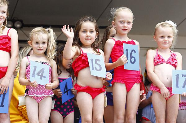 CROWD FRIENDLY: Amylee Knight waves to the crowd as she competes in the 4-6-year age group of Miss Whangamata.