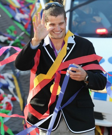 Southland Olympic gold medalist Nathan Cohen acknowledges the crowd during the tickertape parade held through the streets of Invercargill in August.