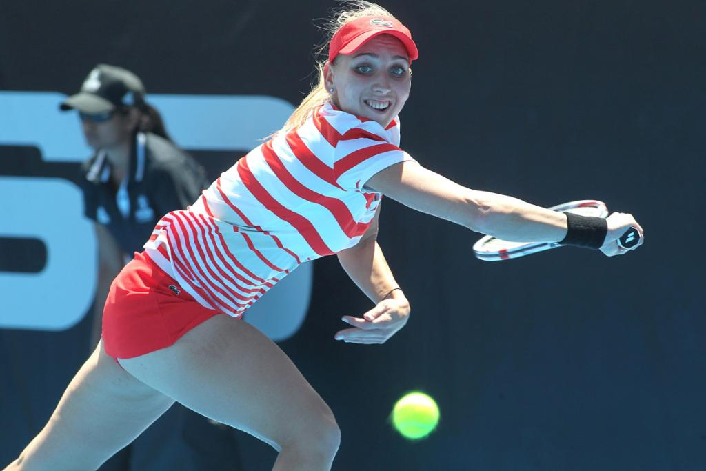 Elena Vesnina stretches to hit a backhand during her first round win over Eugenie Bouchard.