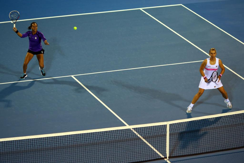 Marina Erakovic of New Zealand, right, and Heather Watson of Great Britain play against Paige Mary Hourigan and Claudia Williams of New Zealand in their first round doubles match.
