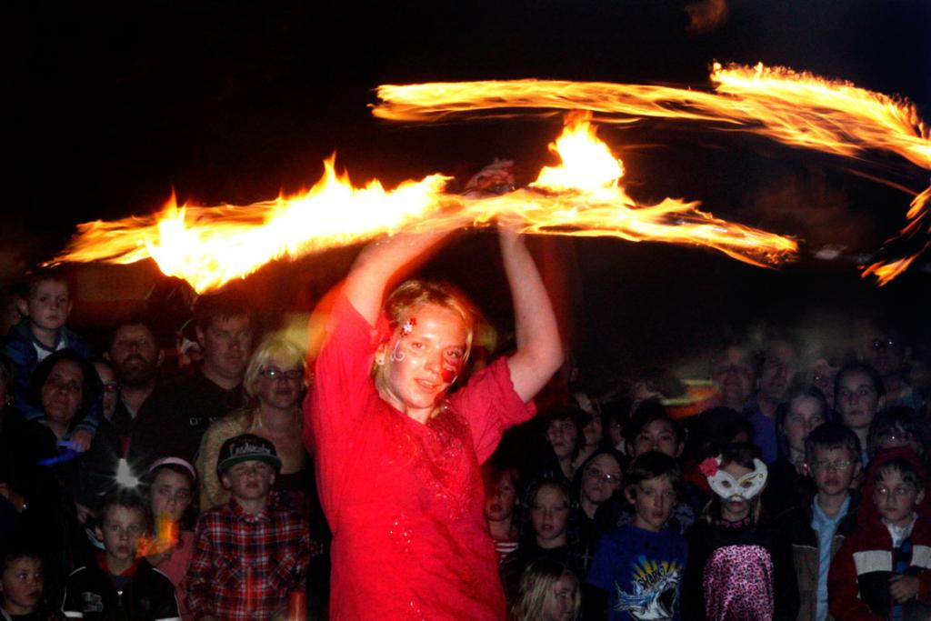 Tania Bracey-Brown performs fire acts with the Wellington group Highly Flammable during a children's performance in The Square, Palmerston North.