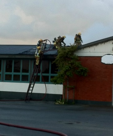 Invercargill firefighters at James Hargest College this morning.