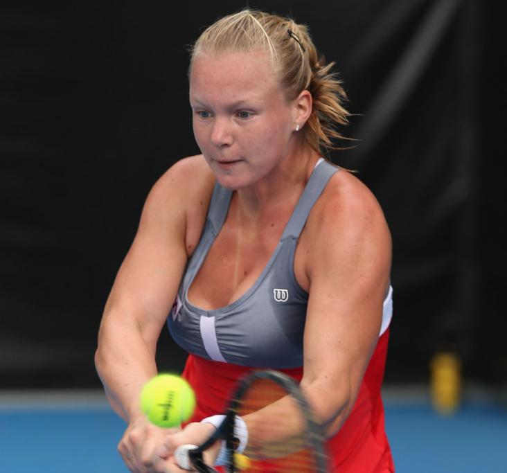 Kiki Bertens of Netherlands plays a backhand in her second round match against Heather Watson of Great Britain during day three of the 2013 ASB Classic in Auckland.