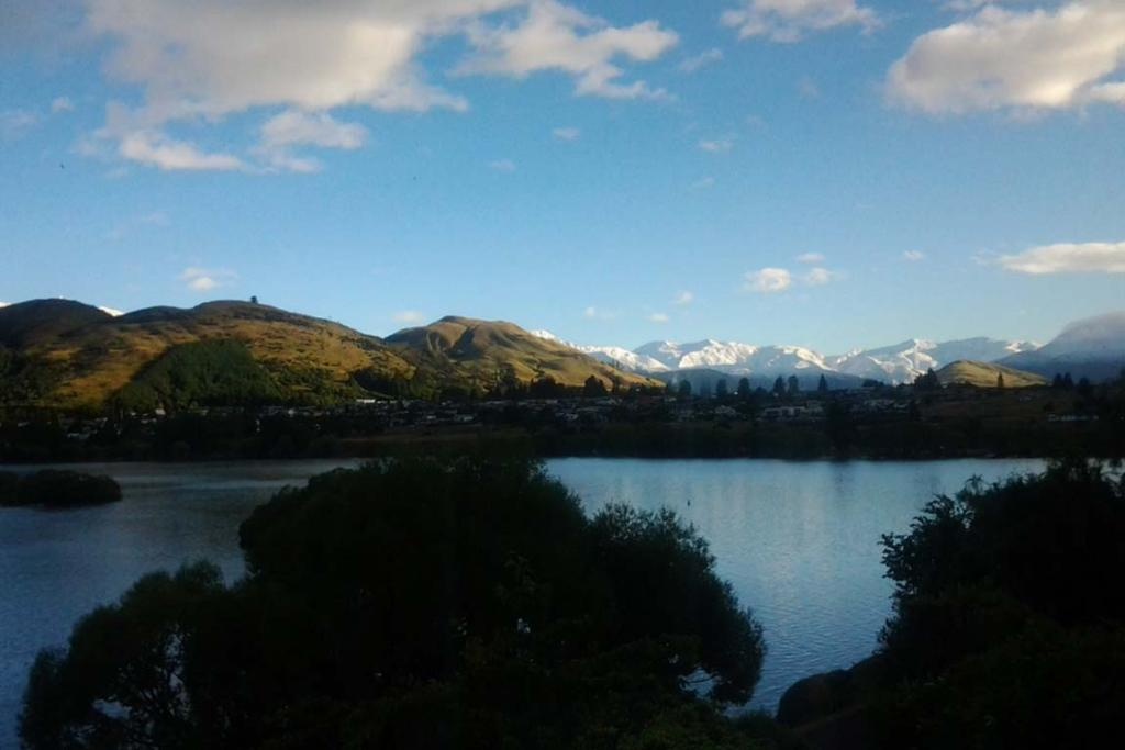 Snow surrounding Queenstown, Coronet Peak to the left and Cardrona in front.