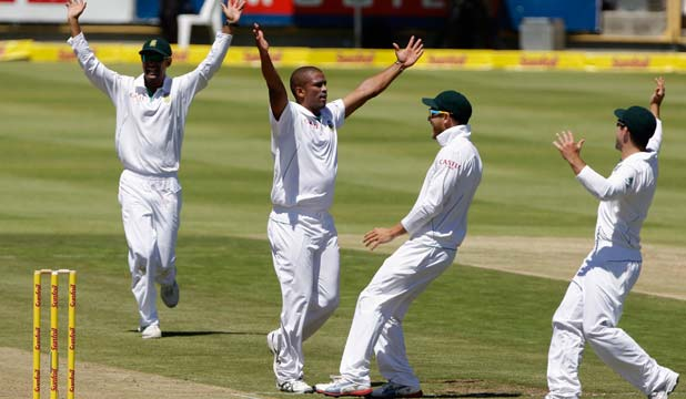 MERCILESS: South Africa's Vernon Philander second left, celebrates a wicket with teammates.