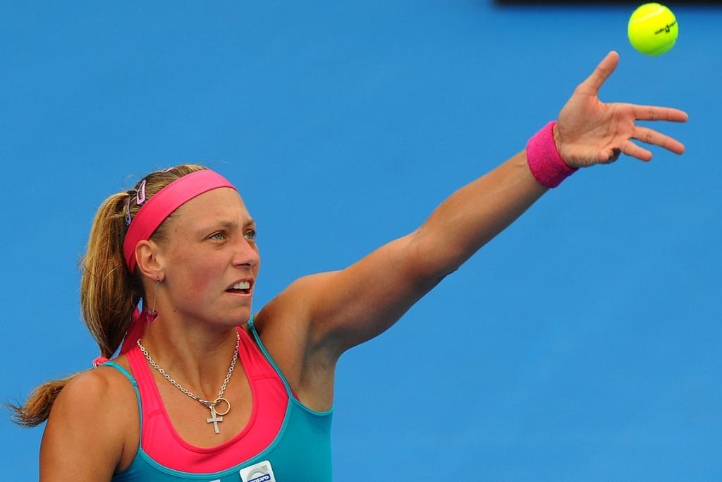 Yanina Wickmayer serves during her quarter-final clash with Kirsten Flipkens.