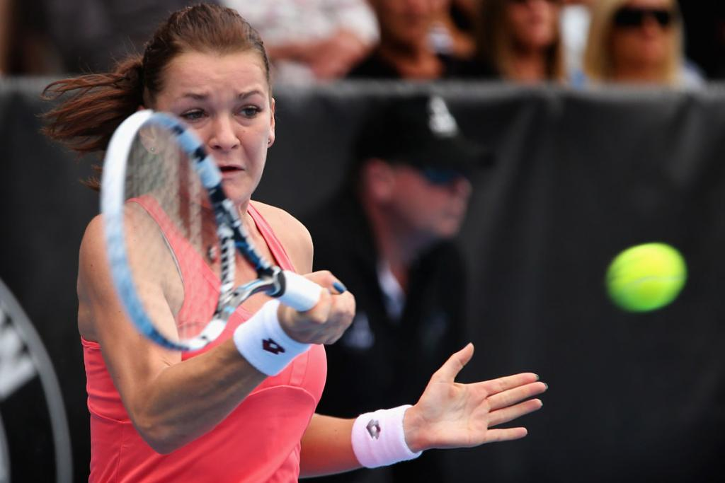 Agnieszka Radwanska of Poland plays a forehand in her quarter final match against Elena Vesnina of Russia.