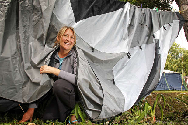 Blown over: Tasha Triplow, who is camping at Havelock Motor Camp, checks her tent that was blown over and drenched in the storm on Wednesday night
