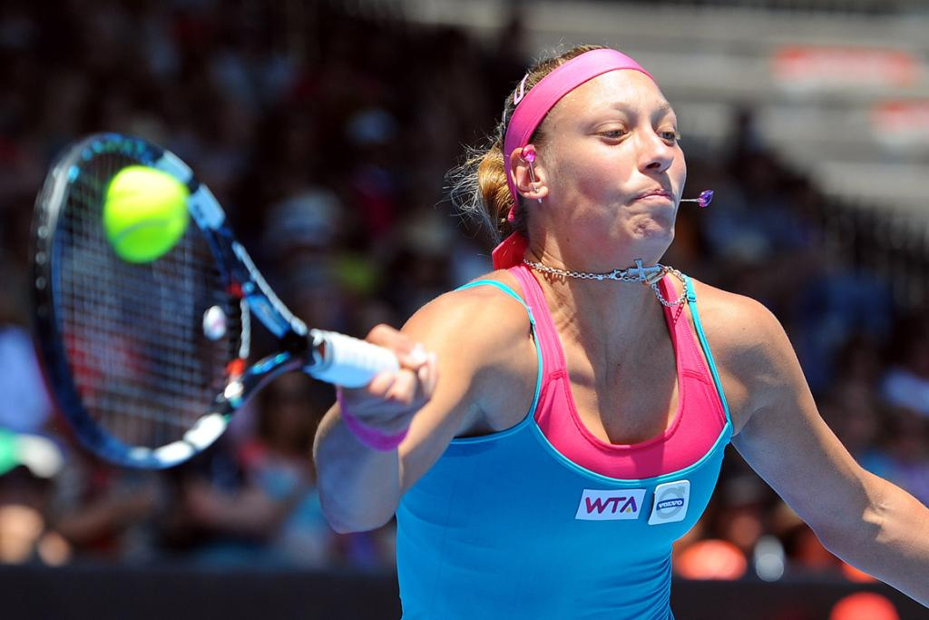 Yanina Wickmayer stretches to hit a forehand during her semifinal win over Mona Barthel.