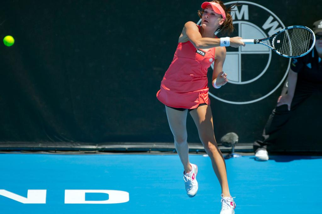 Poland's Agnieszka Radwanska plays a forehand in her first round match against Hungary's Greta Arn during day two of the 2013 ASB Classic.