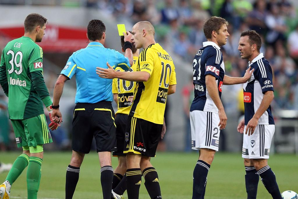Stein Huysegems of the Wellington Phoenix talks to the referee who gave teamate Louis Fenton a yellow card for faking a dive.