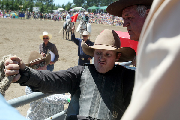 Paul Robinson from Dunback about to be released from the chute at the Canterbury Rodeo in Mandeville, North Canterbury