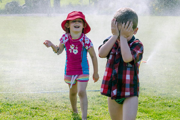 Madilyn Harmer and her cousin, Taylor Harmer cool down in Staveley, Mid Canterbury on Christmas Day.