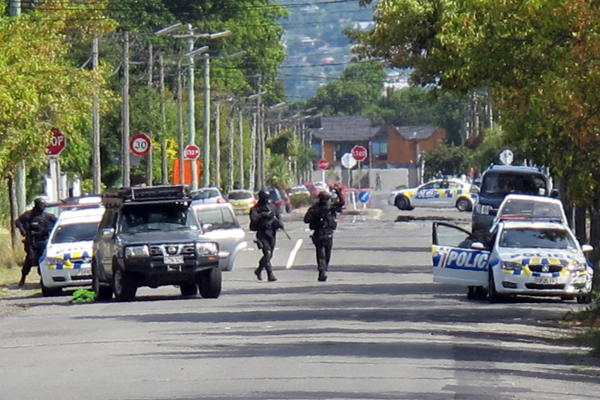 Police cordon off Slater St in Richmond, Christchurch, while the Armed Offenders Squad attends to a call about a weapon that was pulled during a family disagreement.