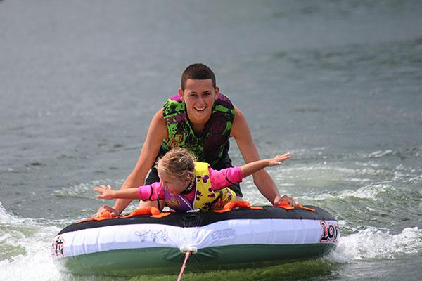 Peyton Varle, 3, and her uncle have fun on the biscuit at Lake Karapiro.