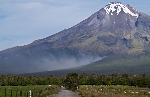 Ash billows into the air on the side of Mt Taranaki on Sunday.
