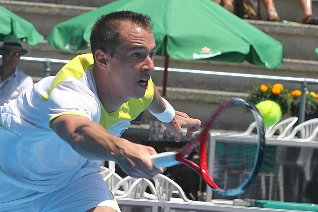 Lukas Rosol on his way to losing his match with Benjamin Becker in straight sets.