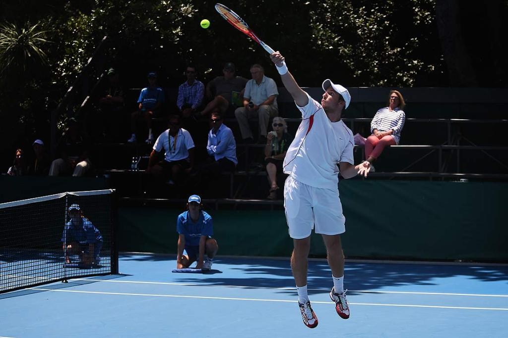Igor Sijsling of Netherlands plays a backhand in his first round match against compatriot Matwe Middelkoop.