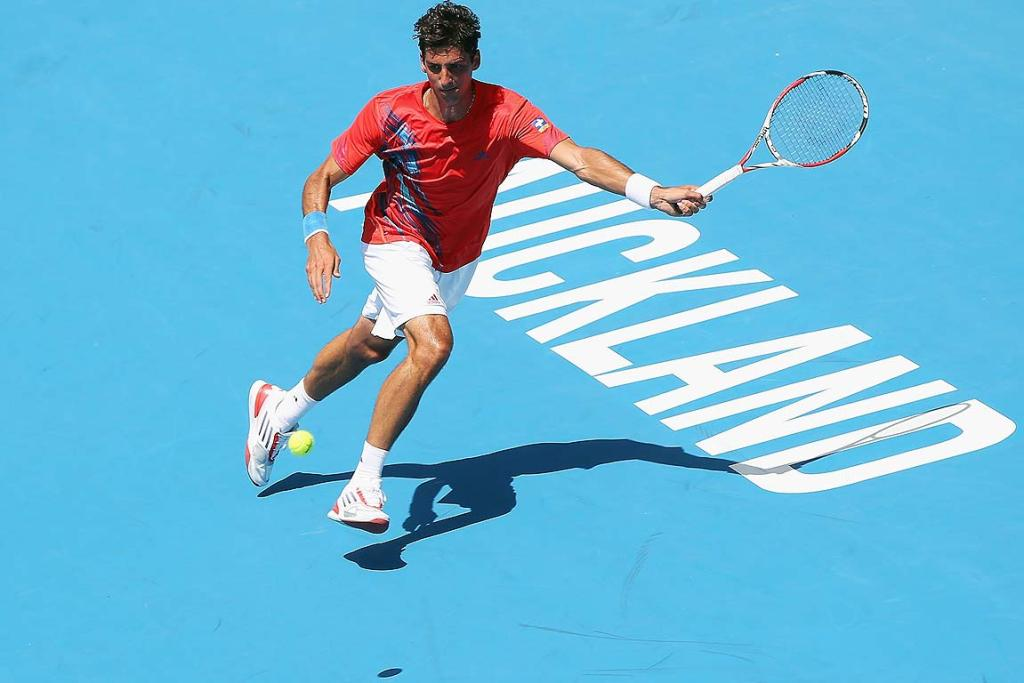 Thomaz Bellucci of Brazil plays a forehand during his first round match against David Goffin of Belgium.