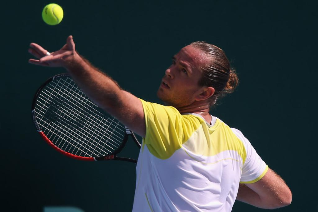 Xavier Malisse showed great composure to claim an upset win in round one over seventh seed Martin Klizan.