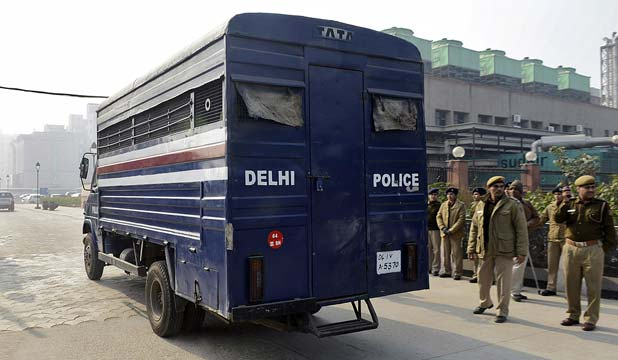 GOING TO COURT: A police van carrying five men accused of the gang rape and murder of an Indian student arrives at a court in New Delhi.
