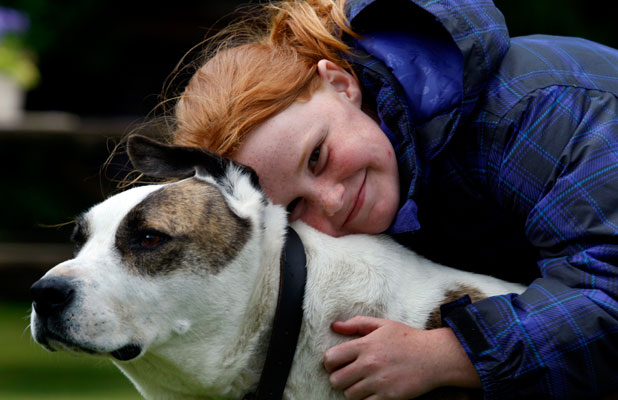 Milly Cox, 8, with family dog Grizzly.