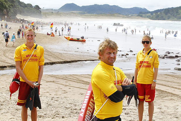 BIG JOB: Hot Water Beach lifeguards Andre Adam, left, Gary Hinds and Katy McVerry have been monitoring nearby Hahei Beach during a big swell on Sunday and Monday.