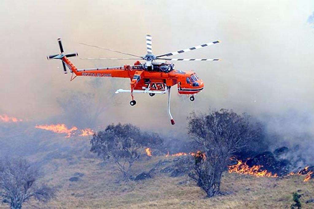 Water bombing at Oura, near Wagga Wagga. New South Wales faces its worst fire risk with temperatures predicted to hit the mid to high 40s.