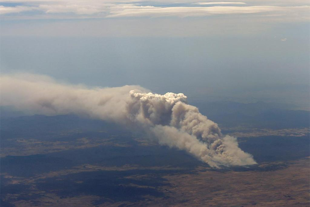 Smoke rises from the Yarrabin bushfire burning out of control near Cooma, south of Canberra.