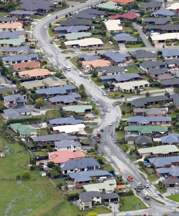 DAMAGE ZONE: An aerial view of Courtenay Dr in February 2011. The houses on the left-hand side of this picture are part of the area which has now been cleared.