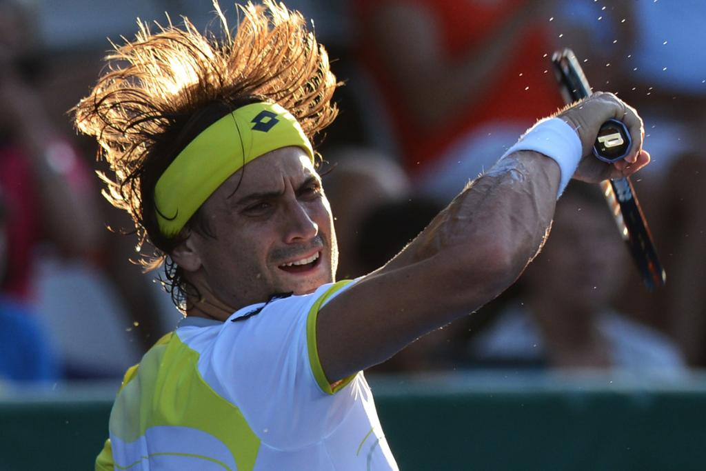 David Ferrer hits a forehand during his three-set win over Lu Yen-Hsun.