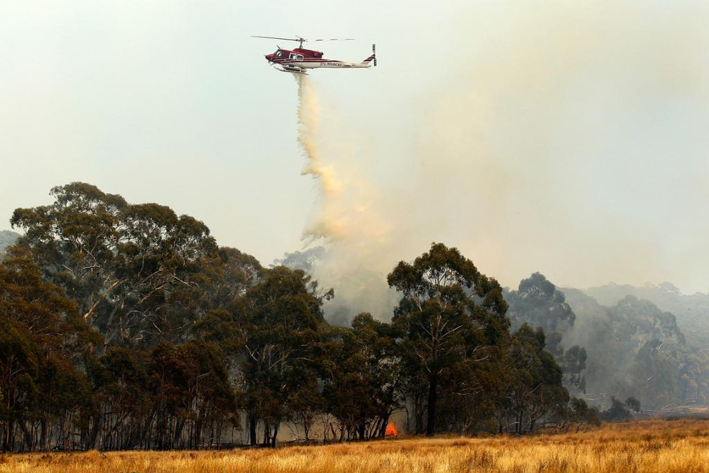 NSW Rural Fire Service crews water-bombing fires at Bungendore.