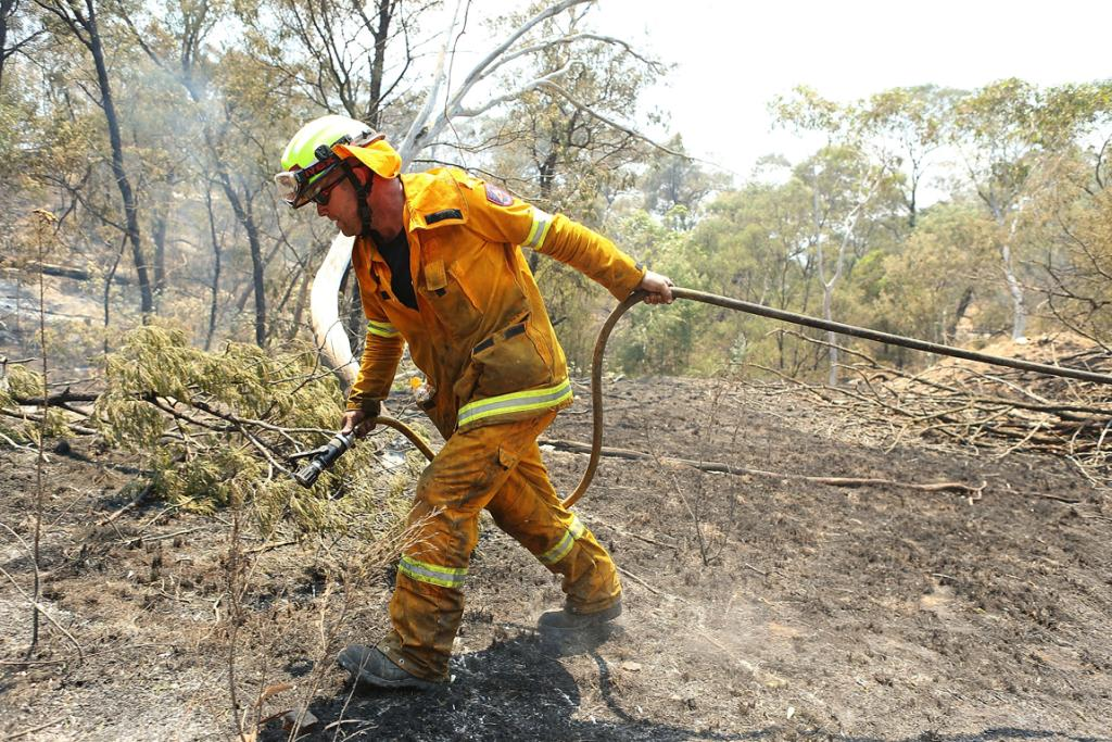 """'Mopping-up"""" spot fires at Sandhills in Bungendore, Australia."""