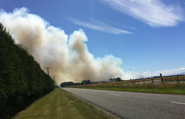 SMOKE PLUME: The fire as seen from Robinsons Road, between Birches and Springs roads.