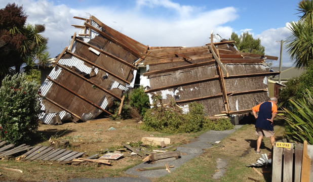UGLY: The roof of a building blown across the road on to a neighbouring property on Beach Rd, Kaikoura.