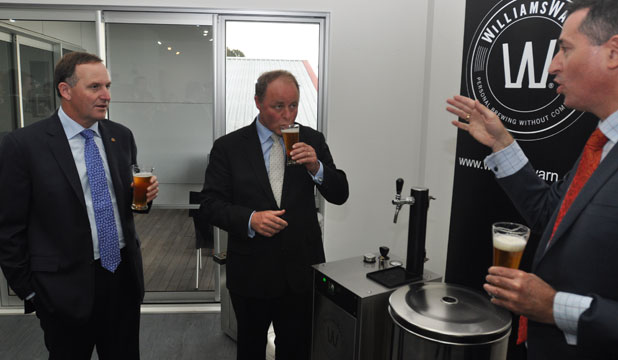Cheers: Prime Minister John Key shares a drink with William Warn co-founder Ian Williams, right, and Tukituki MP Craig Foss.