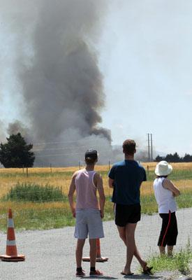 SMOKE PLUME: People gather near the West Melton fire.