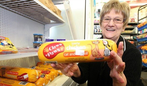 Alray Dairy owner Esmay Hay in her Invercargill store beside the dog roll fridge where Oscar, a thieving, three-legged dog helped himself.