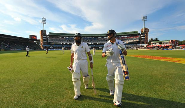 IN CONTROL: Hashim Amla and Faf du Plessis walk from the field after taking South Africa through to 325-4 at stumps on day one of the second test against New Zealand.