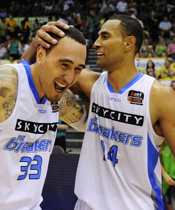 GOOD TIMES: Leon Henry (left) and Mika Vukona celebrate the Breakers win over the Townsville Crocodiles.