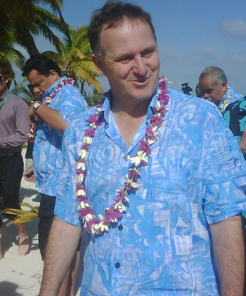 John Key enjoys his summer break in Hawaii - although here he's pictured at work in Fiji at the South Pacific Forum.