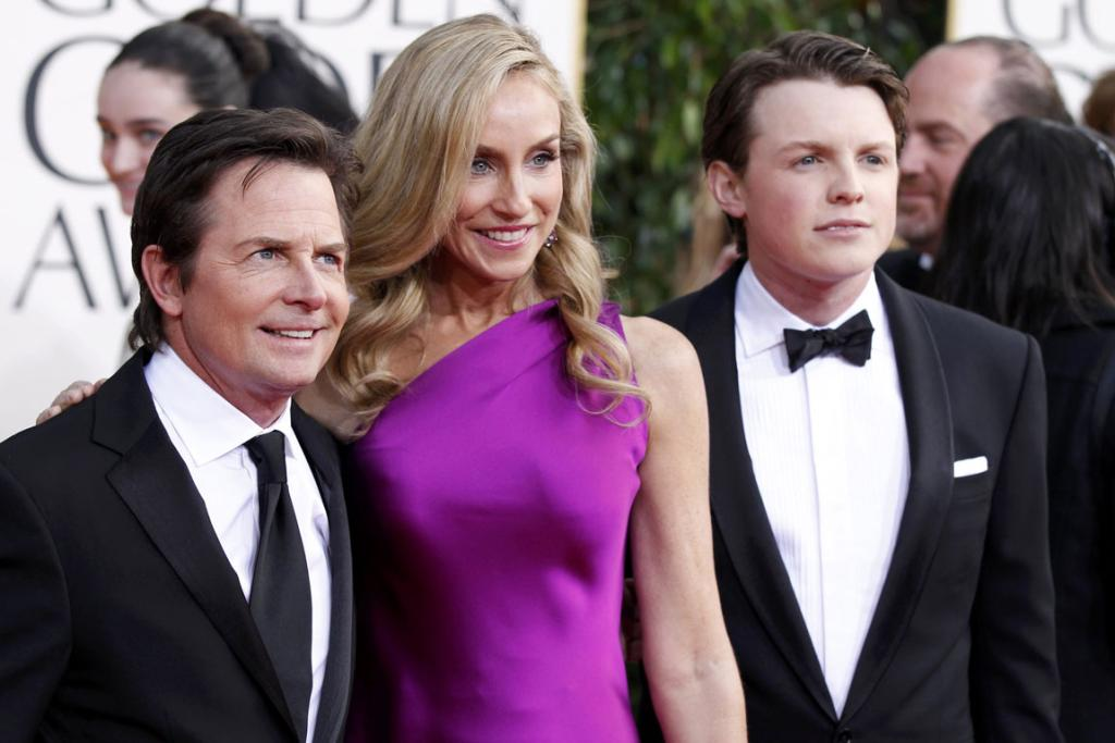Actor Michael J. Fox, his wife Tracy Pollan and their son Sam Fox arrive.