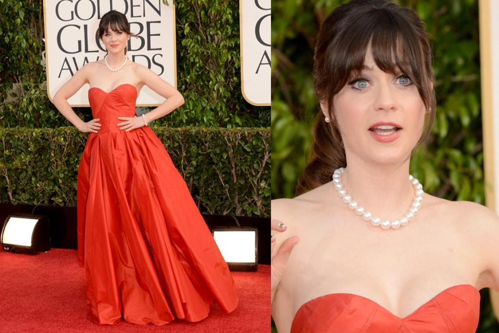 Quirk queen Zooey Deschanel arrives in an Oscar de la Renta dress, which sits somewhere on the colour spectrum between red and orange. You can't really go that wrong with Oscar, but the neckline here looks a little awkward (we just want to get all mum on her and hike it up).