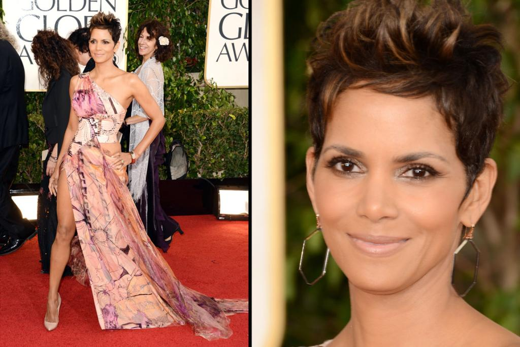 Halle Berry borrowed ferosh-side leg inspiration from Angelina, but the pattern on her Versace dress just does not work: curtains from a dodgy rental pad anyone?