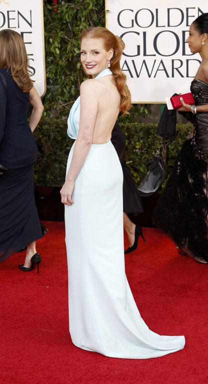 Actress Jessica Chastain is a designer's darling, and this ice blue Calvin Klein gown looks beautiful from the back (although the middle-part makes her forehead look a little Kling On; nothing a side-part wouldn't have fixed).