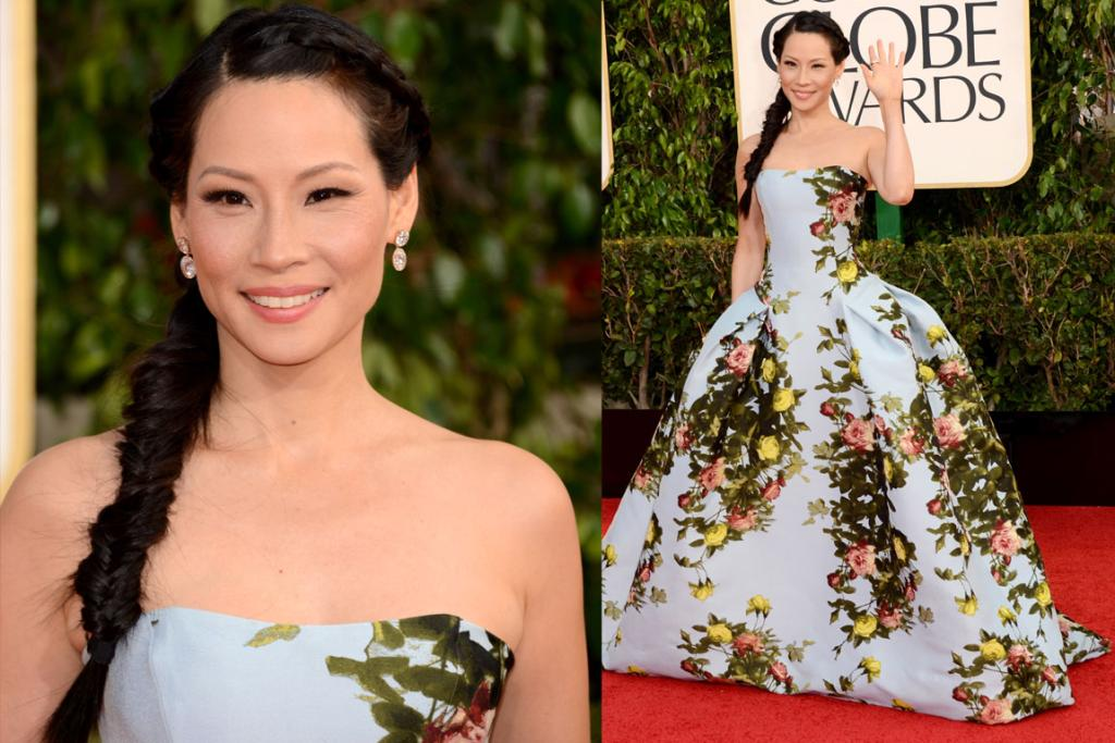 We love the springtime whimsy of Lucy Liu in this Carolina Herrera Pre-Fall 2013 ball gown. So many would've fallen flat on their fash-faces in this, but Liu's tiny waist and artfully simple accessorising and hair means she gets an A.
